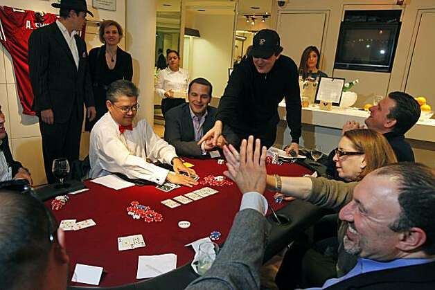 Poker players congratulate each other after splitting the pot. Dozens of Wilkes Bashford's customers and friends attended a charity poker tournament at the downtown San Francisco menÕs clothing store Wednesday Jan 12, 2011. Seventy-two contestants took part at nine tables with eight players to a table. The goal was to raise twenty-five thousand dollars for the Omega Boys Club.  Celebrities included Ronny Lott, and Willie Brown and eleven time World Series of Poker Champion Phil Hellmuth who was the playerÕs host. Photo: Lance Iversen, The Chronicle
