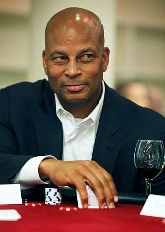 49er All Pro Ronnie Lott studies his fellow gamblers. Dozens of Wilkes Bashford's customers and friends attended a charity poker tournament at the downtown San Francisco menÕs clothing store Wednesday Jan 12, 2011. Seventy-two contestants took part at nine tables with eight players to a table. The goal was to raise twenty-five thousand dollars for the Omega Boys Club.  Celebrities included Willie Brown and eleven time World Series of Poker Champion Phil Hellmuth who was the playerÕs host. Photo: Lance Iversen, The Chronicle