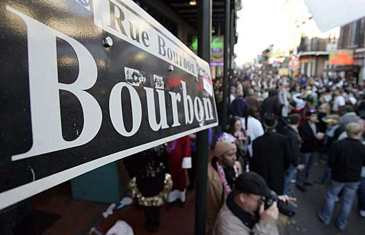 Revelers walk along Bourbon Street in the French Quarter during Mardi Gras day on February 16, 2010 in New Orleans, Louisiana.