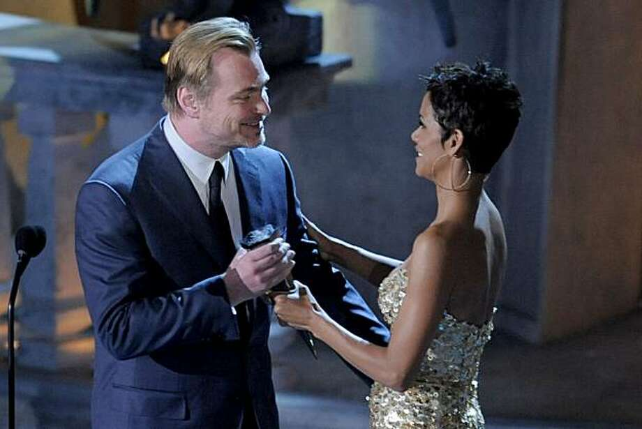 Halle Berry, right, presents Christopher Nolan with the award for Ultimate Scream at the Scream Awards on Saturday Oct. 16, 2010, in Los Angeles. Photo: Chris Pizzello, AP