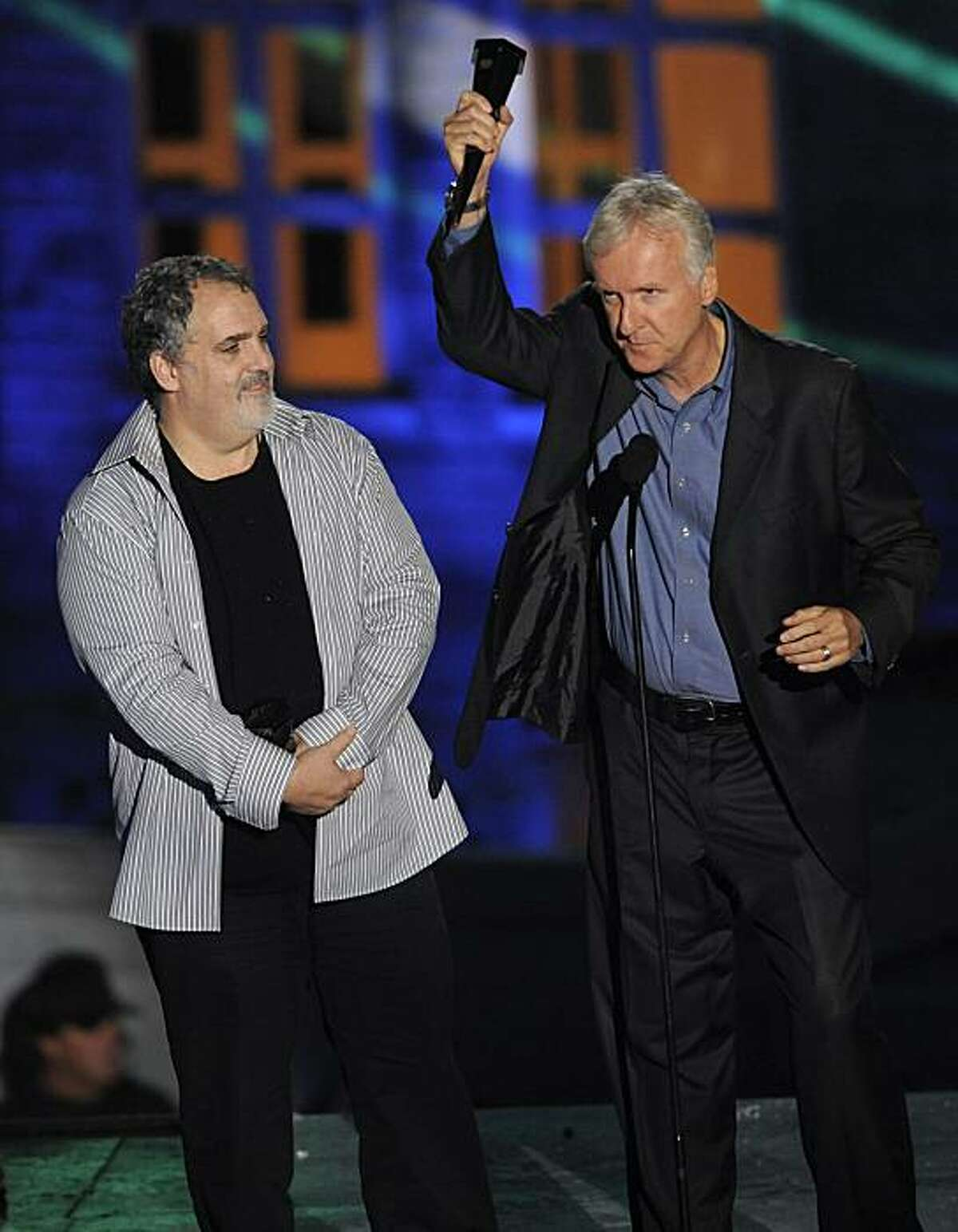 Jon Landau, left, and James Cameron accept the award for 3D Top 3, for Avatar, at the Scream Awards on Saturday Oct. 16, 2010, in Los Angeles.