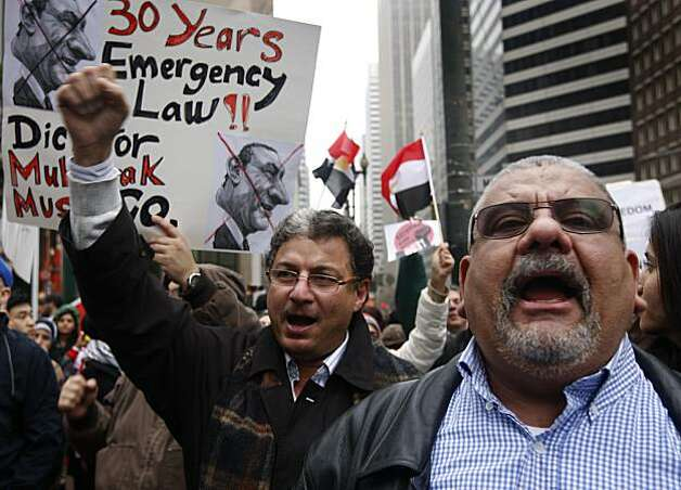 Egyptian Americans Hesham Abdalla (left) and Hesham Mohammad joins hundreds of demonstrators supporting the uprising against President Hosni Mubarak in Egypt at Market and Montgomery streets in San Francisco on Saturday. Photo: Paul Chinn, The Chronicle