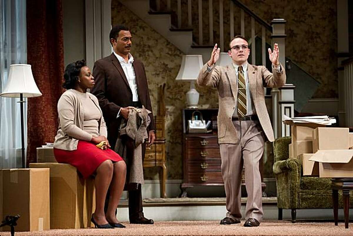 Neighborhood association representative Karl (Richard Thieriot, right) explains the differences between the races to Francine (Omoze Idehenre) and Albert (Gregory Wallace) in the ACT West Coast premiere of Bruce Norris'
