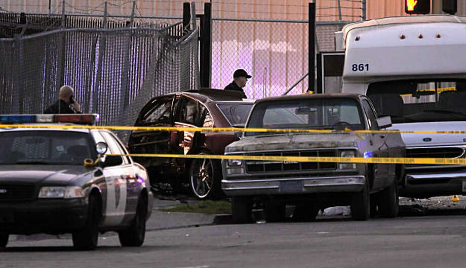 The suspect vehicle on the scene of an officer involved shooting, at San Leandro Blvd. and 85th Ave, that left one suspect dead after a chase by Oakland police through the streets of East Oakland, Ca. on Wednesday Jan. 26, 2011. An Oakland police officer shot and killed a man after he exited the vehicle with two weapons. Photo: Michael Macor, The Chronicle