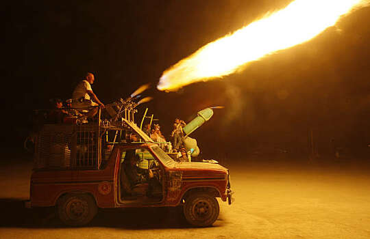 Art cars can be seen shooting flames hundreds of feet up into the night during the Burning Man festival in Black Rock City., NV on September 4, 2009. Photo: Frederic Larson, The Chronicle