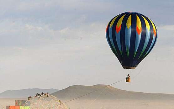 A hot air balloon sails over the playa at the Burning Man festival in Black Rock City., NV on September 4, 2009. Photo: Frederic Larson, The Chronicle