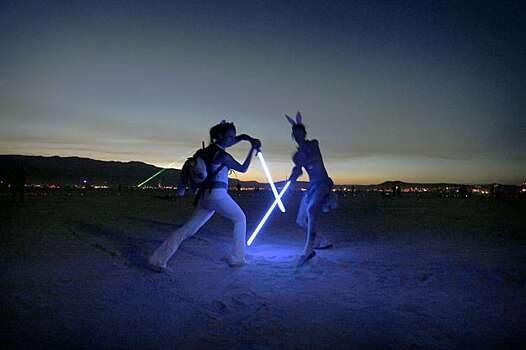Two burners play with their light swords at the Burning Man Festival in Black Rock City, NV., on September 3, 2009. Photo: Frederic Larson, The Chronicle