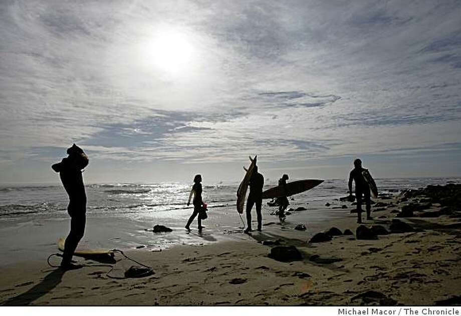 Local surfers gather at the beach to take on the Maverick break as the swell begins to build the afternoon before the event.  One day before the kick off of the Mavericks surf Contest off of Pillar Point near Half Moon Bay. Photo: Michael Macor, The Chronicle