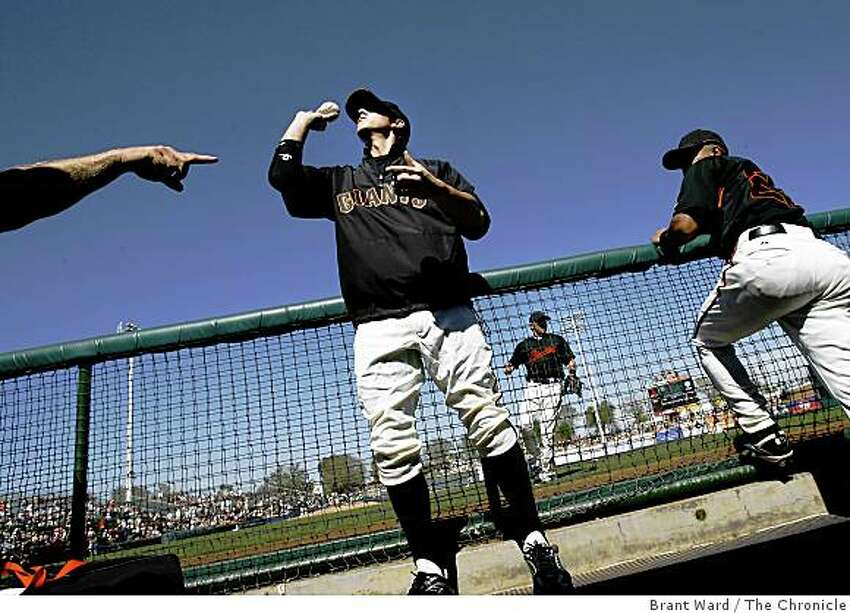 Giants pitcher Tim Lincecum threw a ball back to a fan after signing it Saturday before the game. On March 1, 2008, the San Francisco Giants played the Oakland Athletics in a pre-season exhibition game at Scottsdale Stadium.
