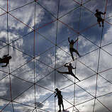Burners hang off an art structure high over the playa at Burning Man on September 2, 2009.