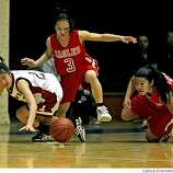Lowell high school guard Kristina Lum (left) battles Washington High Rachelle Hwee #3 and Brittany Woo over the ball in Washington's side of the court during second period AAA girls basketball action at Kezar Pavilion, in San Francisco Tuesday night February 26, 2008