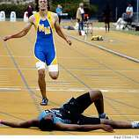 Josh Winfield, of Deer Valley High School, sprawls on the track in front of Newark Memorial's Andrew Akre after Winfield's first place finish in the boys 400 meter run at the North Coast Section track and field championships at Edwards Stadium in Berkeley, Calif., on Saturday, May 24, 2008.