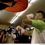 Manny Pacquiao works out on the punching bag at the WestWind School on Saturday, May 31,  2008 in Berkeley , Calif., to promote his lightweight fight with David Diaz next month in Las Vegas.
