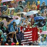 Even with the rain pouring down during the match the stands were still filled with fans. USA wins the gold. Women's team beach volleyball for the gold medal Kerri Walsh and Misty May-Treanor of the USA take on Jie Wang and Jia Tian of China at the 2008 Olympics in Beijing, China, Wednesday  Aug. 20, 2008.