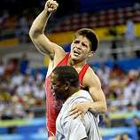 Cejudo gets a lift from his coach Kevin Jackson after his gold medal win. Tony Cejudo, of the USA in Freestyle wrestling captures the gold medal in the 55kg division against his opponent Tomohiro Matsunaga, of Japan,  at the 2008 Olympics in Beijing, China, Tuesday Aug. 19, 2008.