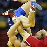 Tony Cejudo, of the USA in Freestyle wrestling captures the gold medal in the 55kg division against his opponent Tomohiro Matsunaga, of Japan,  at the 2008 Olympics in Beijing, China, Monday Aug. 18, 2008.