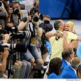 Autralian swimmer Lisbeth Trickett celebrates her win Gold medal in the the 100 meter butterfly hugging her coach after the event, during 2008 Olympic Games, Monday Aug. 11, 2008 in Beijing, China.