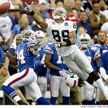 A JaMarcus Russell pass sails past Ronald Curry forcing the Raiders to punt on fourth down late in the fourth quarter against the Buffalo Bills at Ralph Wilson Stadium in Orchard Park, N.Y., on Sunday, Sept. 21, 2008.
