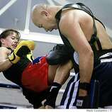 Jenna Castillo spars with Ganyao Faritex in San Francisco, Calif. on Tuesday, October 14, 2008 as part of her training to participate in an upcoming all-female kickboxing championship.