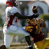 Washington's Solomon Walker, left, deflects a pass intended for Lincoln's Yuzo Shimura as Washington High plays at Lincoln High School in San Francisco, Calif., on Friday, Oct. 17, 2008. Lincoln went on to win, 35-21.