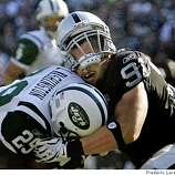 Raiders defensive end Scott Trevor (91) but a great hit on Jets RB (29) Leon Washington near the goal line on Sunday October 19, 2008.