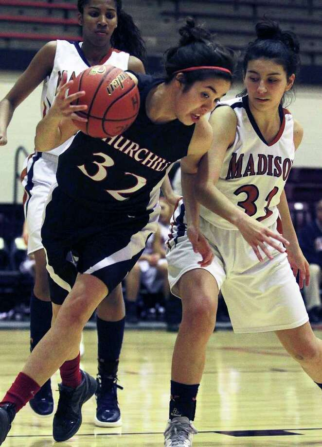 Churchill's Danielle Espinosa rips the ball away from Monica Perez as Churchill plays Madison in girls basketball at Littleton Gym on January 10, 2012 Tom Reel/Staff Photo: TOM REEL, Express-News / © 2011 San Antonio Express-News  MAGS OUT; TV OUT; NO SALES; SAN ANTONIO OUT; AP MEMBERS ONLY; MANDATORY CREDIT; EFE OUT