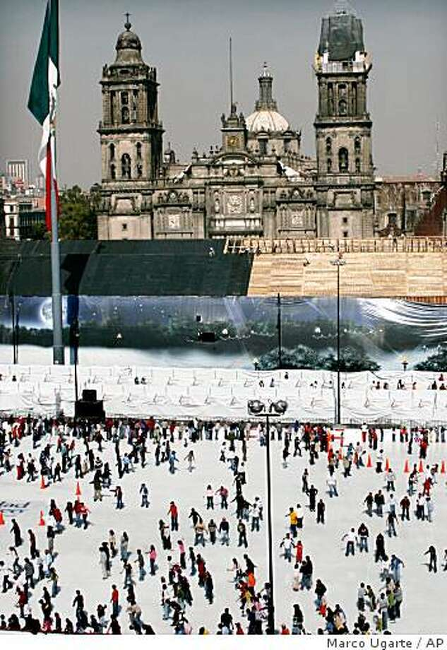 People ice skate on a ring installed at Mexico City's main Zocalo Plaza. Photo: Marco Ugarte, AP