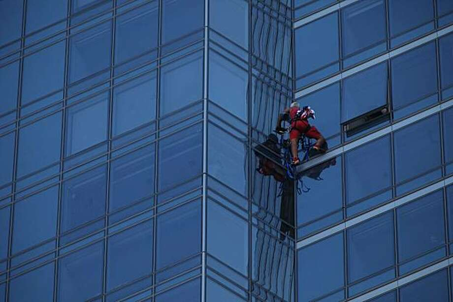 Skyscraper Man makes his way to the top of the Millennium Building on Mission Street on Monday Sept. 6, 2010 in San Francisco, Calif. After reaching the top of the 60 story glass fronted building he was arrested and will likely be charged a misdemeanor.Dan Goodwin, aka Spider Dan,  makes his way to the top of the Millennium Tower on Mission Street on Monday Sept. 6, 2010 in San Francisco, Calif. After reaching the top of the 58-story glass-fronted building he was arrested and will likely be charged with a misdemeanor. Photo: Mike Kepka, The Chronicle