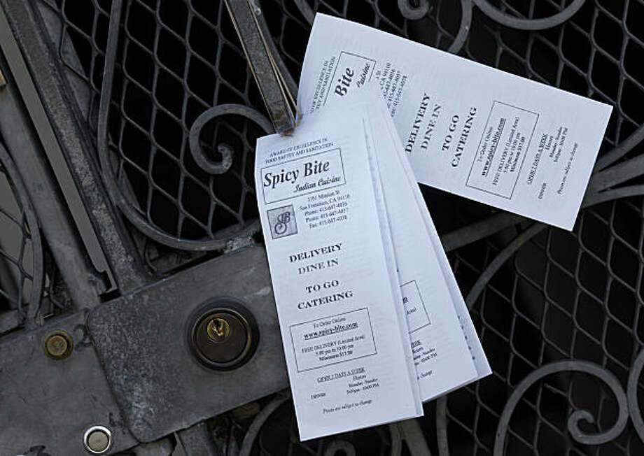 This apartment complex on Dolores Street had enough leaflets for everyone. New legislation proposed by the San Francisco Board of Supervisors may limit the leafleting on front doors and gates in San Francisco, Calif. Monday January 24, 2011. Photo: Brant Ward, The Chronicle
