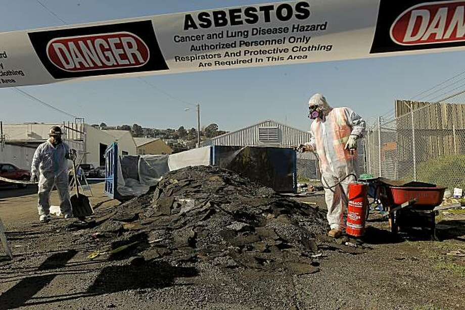 Hazmat crew, Victor Sanchez (left) and Alberto Barragon cleanup an illegal dump of asphalt roofing materials along Newcomb  Ave. at Barneveld Avenue on Friday Jan, 21, 2011. The San Francisco Department of Public Works received a $350 thousand grant to go to the clean up of 25 chronic illegal dumping sites throughout the Bayview neighborhood. Photo: Michael Macor, The Chronicle