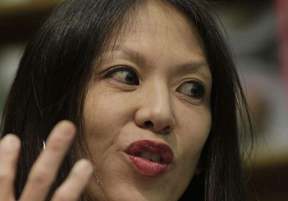 "Author Amy Chua, reads from her new book "" Battle Hymn of the Tiger Mother"", to a huge sold out crowd, Wednesday January 19, 2011, at the Booksmith Bookstore in San Francisco, Calif. Her latest book, has created a controversy because of its contention that Asian moms are better moms than the Western variety. Photo: Lacy Atkins, The Chronicle"