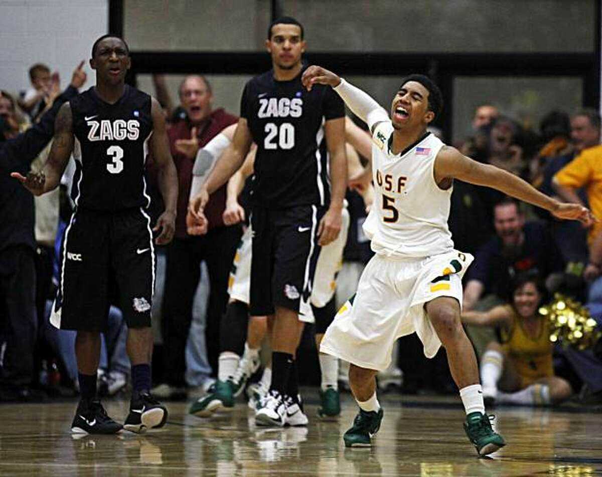 USF's Michael Williams celebrates a Gonzaga foul that sent his teammate Cody Doolin to the foul ine late into overtime. USF Don defeated the Gonzaga Bulldogs at USF's Memorial Gym in San Francisco Saturday, Jan. 22, 2011 96-91 in overtime.