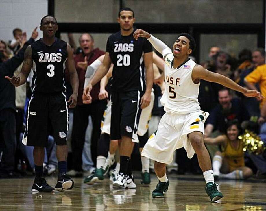 USF's Michael Williams celebrates a Gonzaga foul that sent his teammate Cody Doolin to the foul ine late into overtime. USF Don defeated the Gonzaga Bulldogs at USF's Memorial Gym in San Francisco Saturday, Jan. 22, 2011 96-91 in overtime. Photo: Lance Iversen, The Chronicle
