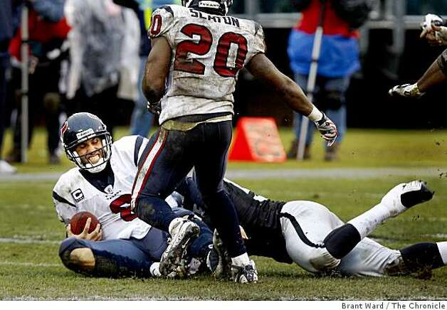 Texans' quarterback Matt Schaub is sacked by the Raiders' Derrick Burgess in the third quarter. Photo: Brant Ward, The Chronicle