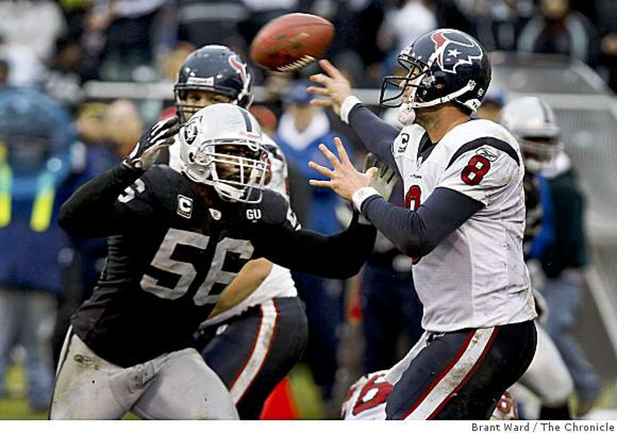 Texas quarterback 8 Matt Schaub is pressured by 56 Derrick Burgess in the fourth quarter which results in an incomplete pass. The Oakland Raiders vs the Houston Texans Sunday, December 21, 2008.