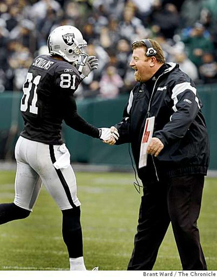 Raiders head coach Tom Cable congratulates Chaz Schilens (81) after his first quarter TD. Photo: Brant Ward, The Chronicle
