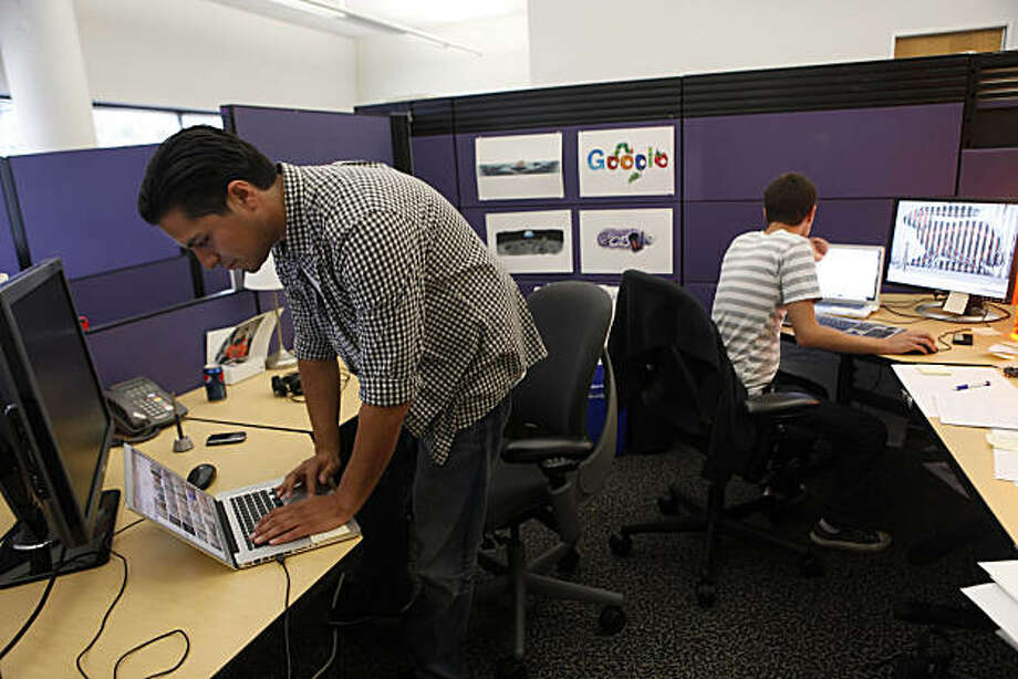 Google Chief Doodler Michael Lopez (left) sets up his laptop at his desk at Google in Mountain View, Calif. on Tuesday August 20, 2010. Photo: Lea Suzuki, The Chronicle