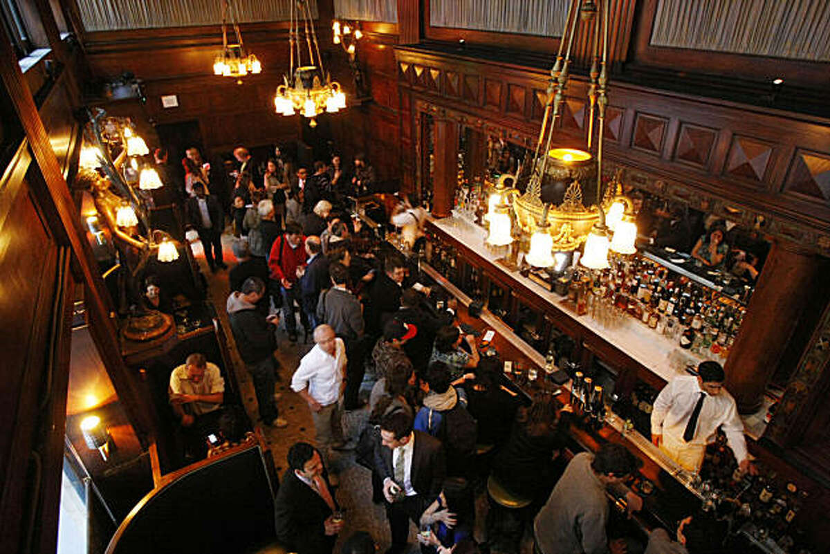 Patrons engage in drinks and conversation at House of Shields bar in San Francisco Calif. on Friday, Jan. 21, 2011. The bar recently underwent a change of hands and thorough cleaning to restore it back to its 1918 appearance.