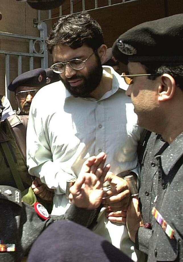 **HOLD FOR RELEASE UNTIL THURSDAY, JAN. 20, 2011, AT 12:01 A.M. EST** FILE - In this March 29, 2002 file photo, Ahmed Omar Saeed Sheikh, the alleged mastermind behind Wall Street Journal reporter Daniel Pearl's abduction, leaves the provincial high courtin Karachi, Pakistan, under tight security. The results of the Pearl Project, an investigation carried out by a team of American journalists and students and spanning more than three years, raise troubling questions about Pakistan's dysfunctional criminaljustice system and underscore the limits U.S. officials face in relying on Pakistani authorities. Photo: Zia Mazhar, AP