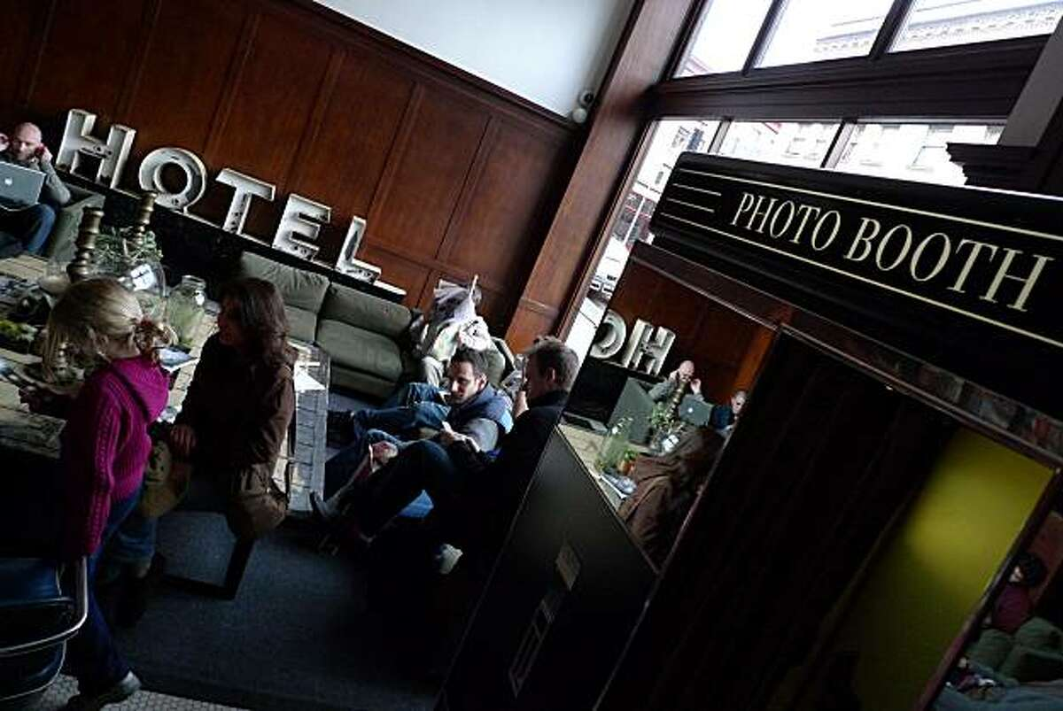 Among the popular features in the lobby at the Ace Hotel in Portland is a working pre-digital photo booth. Other features include rental bikes and a few rooms equipped with working turntables.