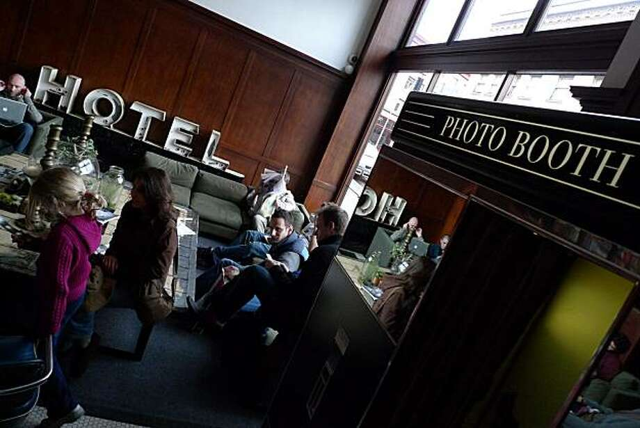 Among the popular features in the lobby at the Ace Hotel in Portland is a working pre-digital photo booth. Other features include rental bikes and a few rooms equipped with working turntables. Photo: Spud Hilton, The Chronicle