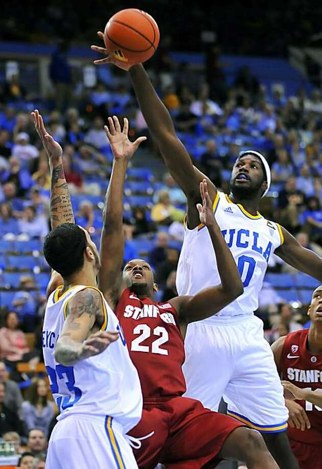 Stanford's Jarrett Mann (22) has his shot blocked as he tries to shoot between UCLA's Anthony Stover, right, and Tyler Honeycutt in the first half of an NCAA college basketball game, Saturday, Jan. 22, 2011, in Los Angeles. Photo: Richard Hartog, AP