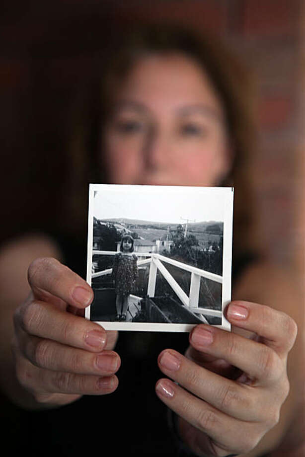 Karen Kupetz, homeowner of one of the houses destroyed in the San Bruno gas explosion, holds a photo of herself. As a child she grew up with her parents in the same house that was leveled by the fire. Photo: Stefano Paltera, Special To The Chronicle