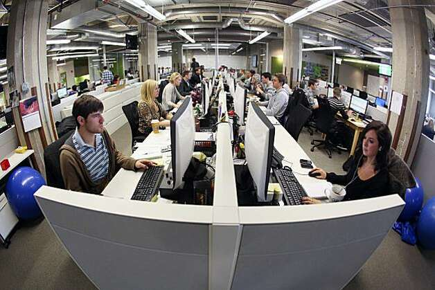 Groupon Inc. team members work at the company's headquarters in Chicago, Illinois, U.S., on Tuesday, Dec. 14, 2010. Groupon, the startup provider of online coupons with more than 35 million users, rejected a $6 billion offer from Google Inc. earlier this month, betting it can keep increasing its valuation. Photographer: Tim Boyle/Bloomberg Photo: Tim Boyle, Bloomberg