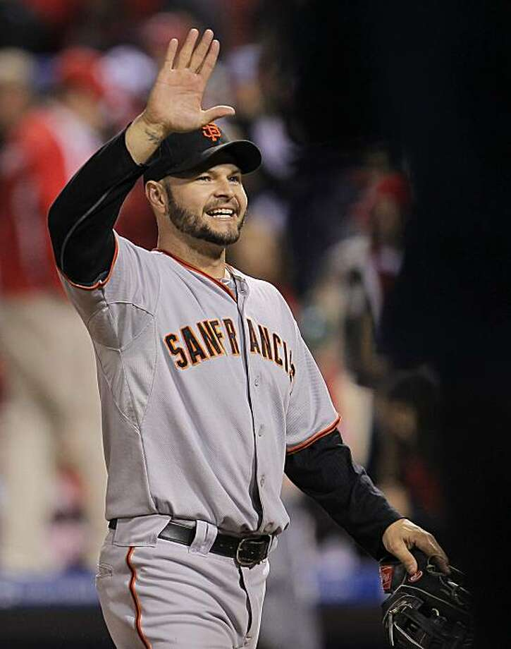 The Giants' Cody Ross celebrates their win against the Philadelphia Phillies in Game 1 of the National League Championship Series on Saturday at Citizens Bank Park in Philadelphia. Photo: Michael Macor, The Chronicle