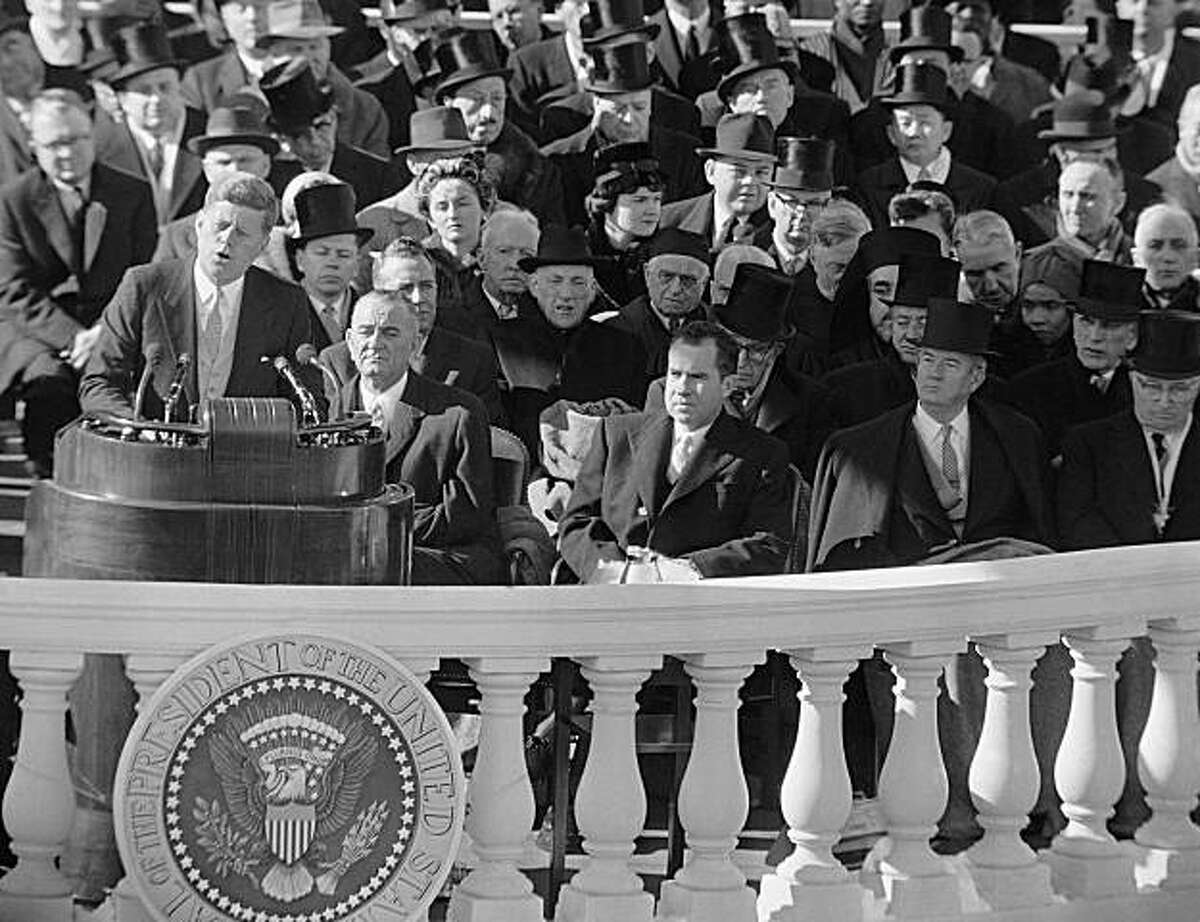 ** FILE ** In this Jan. 20, 1961, file photo, President John F. Kennedy gives his inaugural address at the Capitol in Washington after he took the oath of office. Listening in front row of inaugural seats, from left, are, Vice President Lyndon B. Johnson, Richard M Nixon, Kennedy's campaign opponent, Sen John Sparkman of Alabama, and former President Harry Truman. (AP Photo, File)