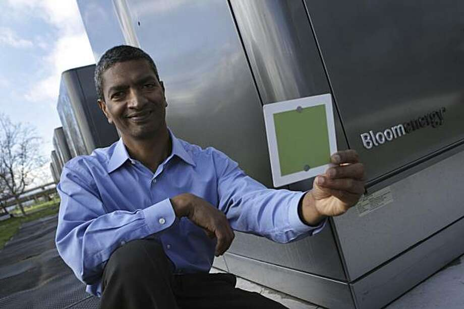 K.R. Sridhar, co-founder and CEO of Silicon Valley startup Bloom Energy, holds up a fuel cell in front of a line of Bloom Energy Servers at eBay offices in San Jose, Calif., Wednesday, Feb. 24, 2010. The company's first product is a huge box of fuel cells that it hopes will allow homes and businesses to generate their own electricity. Photo: Lea Suzuki, The Chronicle