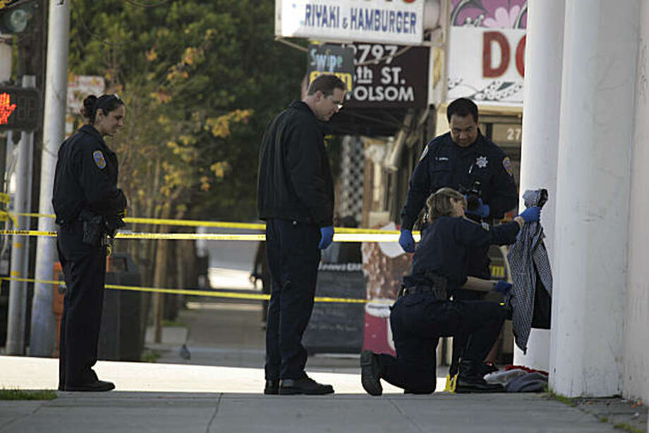 Crime scene investigators work at the scene of a shooting on 16th and Folsom Streets on Tuesday, January 18, 2011 in San Francisco, Calif. A 22-year-old man was shot and wounded this morning while getting off a Muni bus in the Mission District, police said. Photo: Lea Suzuki, The Chronicle