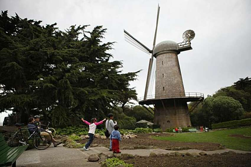 Visitors to the west end of Golden Gate Park enjoy the Dutch Windmill and the Queen Wilhelmina Garden in San Francisco, Calif. on Sunday October 18, 2009.