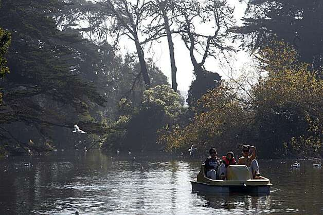 Efforts to make Golden Gate Park a landmark would conflict with the Recreation and Park Department's effort to make improvements to the Stow Lake Boat House as the Laserna family from Daly City use the paddle boats today at Stow Lake in San Francisco, Calif., on Monday, January 17, 2011.  Left to right--Erick Laserna, Leila Laserna, 4 years old, and Analie Laserna. Photo: Liz Hafalia, The Chronicle
